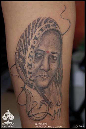 Portrait Tattoos on Arm of Mother
