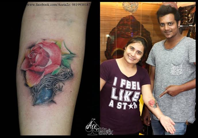 ROSE FLOWER TATTOO WITH BIRD SPARROW TATTOO.