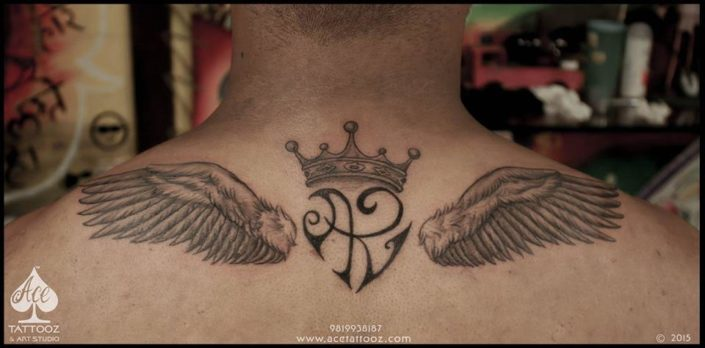 Back Tattoo Designs for Men with Crown and Wing
