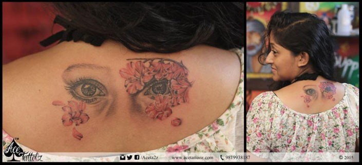 Back Tattoo with Eyes and Flowers