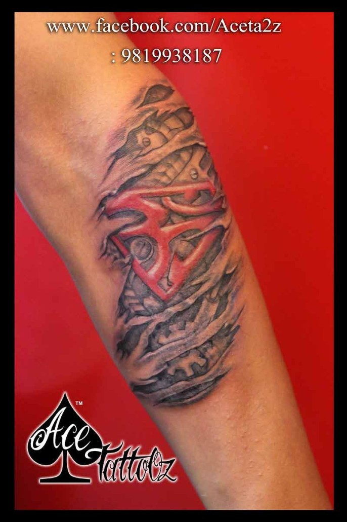 Biomechanical Om tattoo