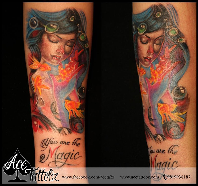 Beautiful Mermaid with fishes tattoo