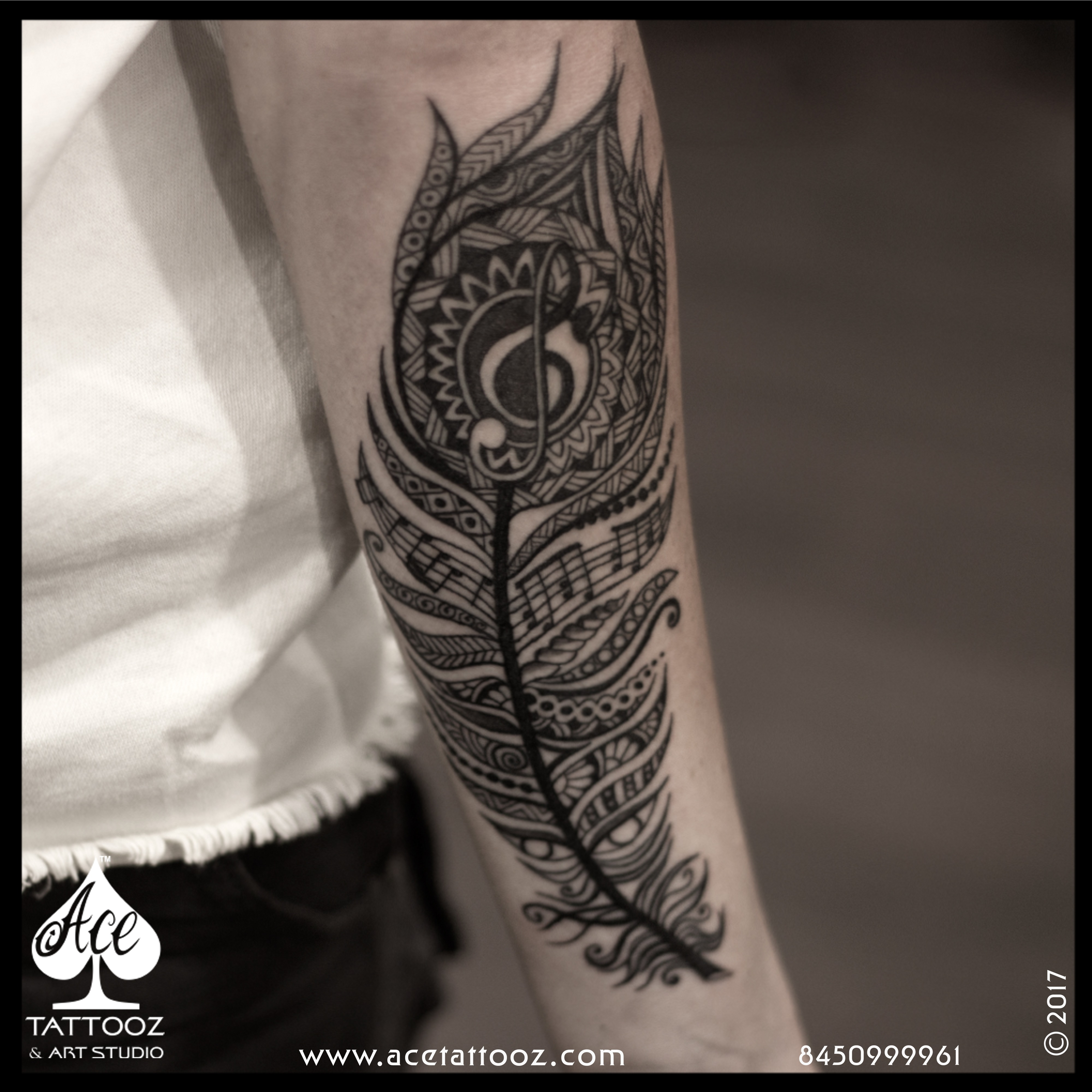 Feather arm tattoo