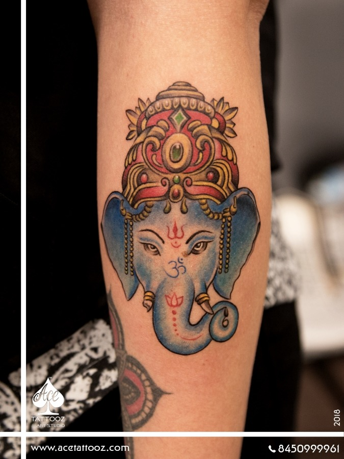 lord ganesha face tattoo ace tattooz. Black Bedroom Furniture Sets. Home Design Ideas